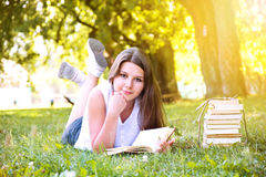 Girl reading a book. Stock Photos