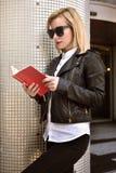 Girl reading book Stock Image