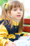 Girl reading a book. Young girl reading a book  at the park Stock Image