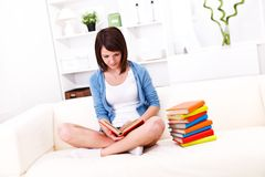 Girl reading books Stock Photography