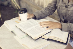 Girl reading books with cup of coffee Stock Photos