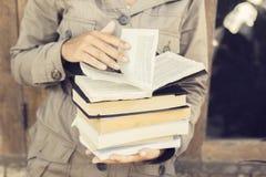 Girl reading a books outdoors Stock Photos