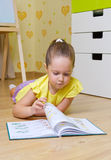 Girl reading box in a home Royalty Free Stock Image