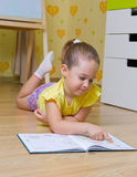 Girl reading box in a home Royalty Free Stock Photo