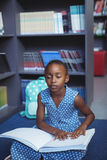 Girl reading braille in library Royalty Free Stock Photos
