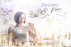 Girl reading business plan Stock Photo