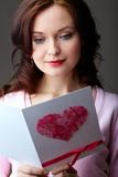 Girl reading card Stock Photos