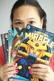 Girl reading comic books royalty free stock photo