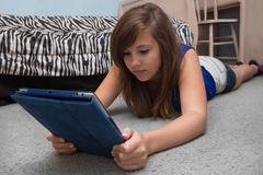 Girl Reading Digital Book Stock Images