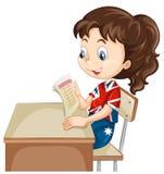 Girl reading document on the desk Stock Images