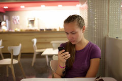 Girl reading email by phone Royalty Free Stock Photography