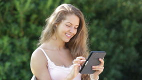 girl  reading  ereader Royalty Free Stock Photography