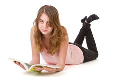 Girl reading on floor Stock Photography