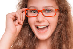 Girl with reading glasses stock photos