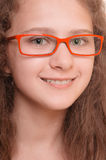 Girl with reading glasses Stock Images