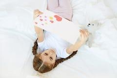 Girl Reading Handmade Card stock photos