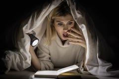 Girl Reading Horror Book Stock Images