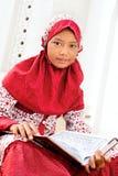Girl Reading Koran Royalty Free Stock Image