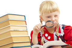 Girl reading with loupe. Little girl reading with loupe Royalty Free Stock Images