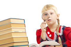 Girl reading with loupe Royalty Free Stock Photos