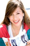 Girl reading magazine Royalty Free Stock Images
