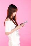 Girl reading a magazine. Royalty Free Stock Image
