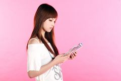 Girl reading a magazine. Stock Photo
