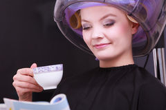 Girl reading magazine drinking coffee hair salon Stock Photography