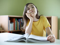 Girl reading magazines Stock Image