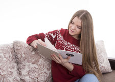 Girl reading a message. Girl reading a Christmas greeting Royalty Free Stock Images