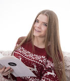 Girl reading a message. Girl reading a Christmas greeting Stock Photo