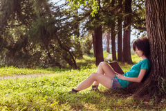 Girl reading in the nature Stock Photography