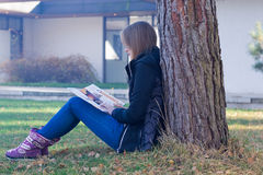Girl reading on nature Royalty Free Stock Image