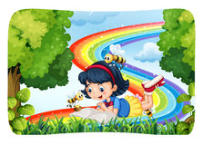 Girl reading in nature with rainbow Royalty Free Stock Photo