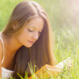 Girl reading in nature Stock Photos