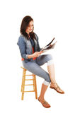 Girl reading newspaper. Royalty Free Stock Images