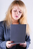 Girl reading a notebook Stock Image