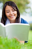 Girl reading outdoors Royalty Free Stock Photos