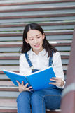 Girl reading outdoors Stock Photography