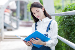 Girl reading outdoors Stock Images