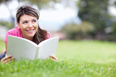 Girl reading at the park Royalty Free Stock Images