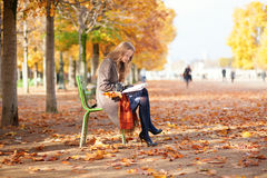 Girl reading in park Stock Photography