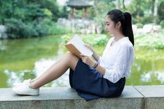Girl reading in the park Stock Image