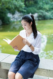 Girl reading in the park Stock Photography