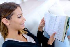 Girl reading phrases in book. Girl reading phrases in the book Royalty Free Stock Photo