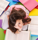 Girl reading pile colored book. Stock Image