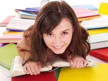 Girl reading pile colored book. Royalty Free Stock Photography