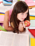 Girl reading pile colored book. Royalty Free Stock Photos