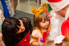 Girl Reading poetry to Santa Stock Images