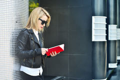 Girl reading red  book Stock Photo